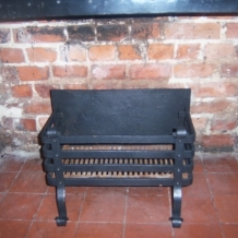 A LARGE WROUGHT IRON FIRE BASKET