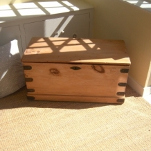 AN ANTIQUE STRIPPED PINE CHEST