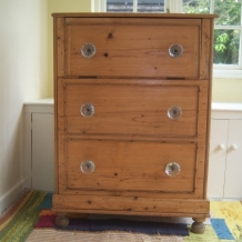 AN ANTIQUE FALSE DRAWER BLANKET CHEST