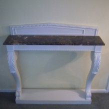 AN ANTIQUE MARBLE TOPPED PIER TABLE
