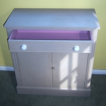A GREY AND LAVENDER CABINET