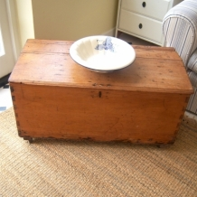 ANTIQUE PINE CHEST ON CASTORS