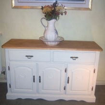 AN ANTIQUE STYLE PAINTED SIDEBOARD